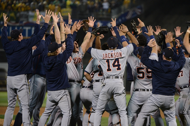 October 10, 2013; Oakland, CA, USA; Detroit Tigers players celebrate after game five of the American League divisional series playoff baseball game against the Oakland Athletics at O.co Coliseum. The Tigers defeated the Athletics 3-0. Mandatory Credit: Kyle Terada-USA TODAY Sports