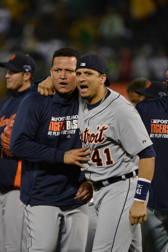 October 10, 2013; Oakland, CA, USA; Detroit Tigers third baseman Miguel Cabrera (24, left) and designated hitter Victor Martinez (41) celebrate after game five of the American League divisional series playoff baseball game against the Oakland Athletics at O.co Coliseum. The Tigers defeated the Athletics 3-0. Mandatory Credit: Kyle Terada-USA TODAY Sports