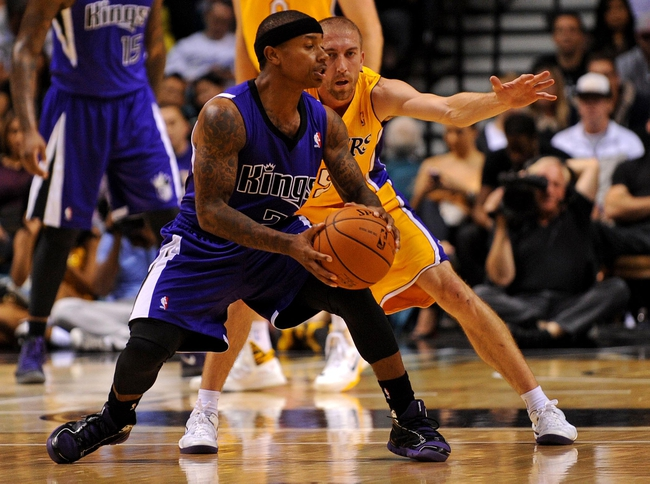 Oct 10, 2013; Las Vegas, NV, USA; Sacramento Kings guard Isaiah Thomas (22) protects the ball from defending Los Angeles Lakers guard Steve Blake (5) during an NBA preseason game at MGM Grand Arena. The Kings won the game 104-86. Mandatory Credit: Stephen R. Sylvanie-USA TODAY Sports