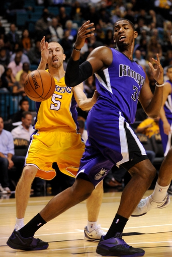 Oct 10, 2013; Las Vegas, NV, USA; Sacramento Kings forward Jason Thompson (34) loses control of the ball while being defended by Los Angeles Lakers guard Steve Blake (5) during an NBA preseason game at MGM Grand Arena. The Kings won the game 104-86. Mandatory Credit: Stephen R. Sylvanie-USA TODAY Sports