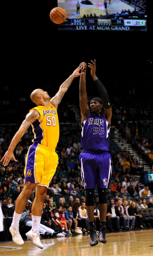 Oct 10, 2013; Las Vegas, NV, USA; Sacramento Kings center Hamady Ndiaye (55) takes a jump shot against the defense of Los Angeles Lakers center Robert Sacre (50) during an NBA preseason game at MGM Grand Arena. The Kings won the game 104-86. Mandatory Credit: Stephen R. Sylvanie-USA TODAY Sports