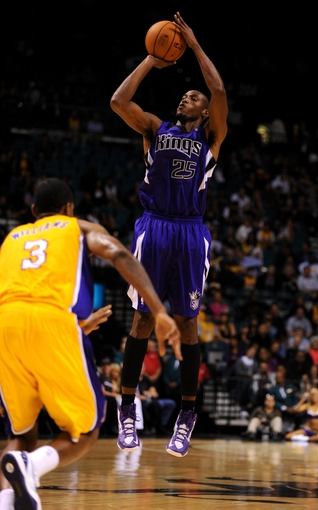 Oct 10, 2013; Las Vegas, NV, USA; Sacramento Kings forward Travis Outlaw (25) attempts a jump shot against Los Angeles Lakers forward Shawne Williams (3) during an NBA preseason game at MGM Grand Arena. The Kings won the game 104-86. Mandatory Credit: Stephen R. Sylvanie-USA TODAY Sports