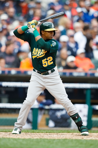 Oct 7, 2013; Detroit, MI, USA; Oakland Athletics left fielder Yoenis Cespedes (52) at bat against the Detroit Tigers in game three of the American League divisional series playoff baseball game at Comerica Park. Mandatory Credit: Rick Osentoski-USA TODAY Sports