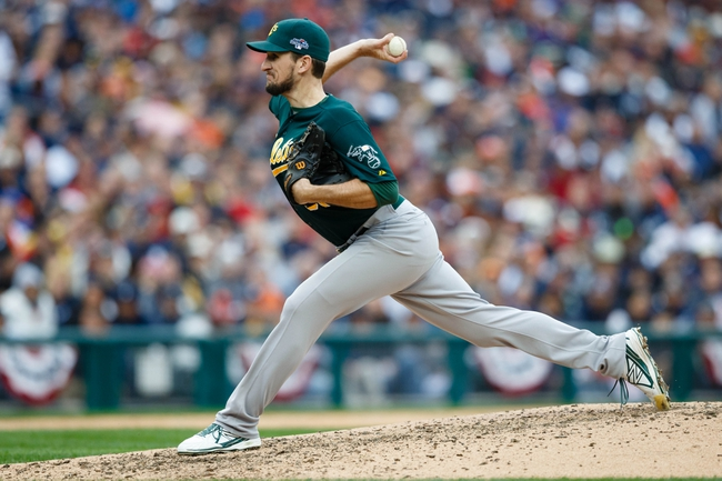 Oct 7, 2013; Detroit, MI, USA; Oakland Athletics relief pitcher Dan Otero (61) pitches in the sixth inning against the Detroit Tigers in game three of the American League divisional series playoff baseball game at Comerica Park. Mandatory Credit: Rick Osentoski-USA TODAY Sports