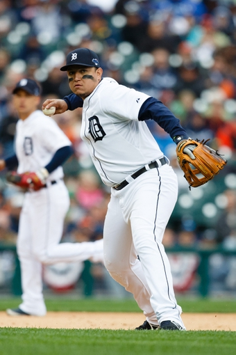 Oct 7, 2013; Detroit, MI, USA; Detroit Tigers third baseman Miguel Cabrera (24) makes a throw to first for on an out during the ninth inning against the Oakland Athletics in game three of the American League divisional series playoff baseball game at Comerica Park. Mandatory Credit: Rick Osentoski-USA TODAY Sports