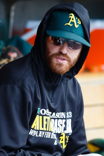 Oct 7, 2013; Detroit, MI, USA; Oakland Athletics starting pitcher Dan Straily (67) in the dugout against the Detroit Tigers in game three of the American League divisional series playoff baseball game at Comerica Park. Mandatory Credit: Rick Osentoski-USA TODAY Sports
