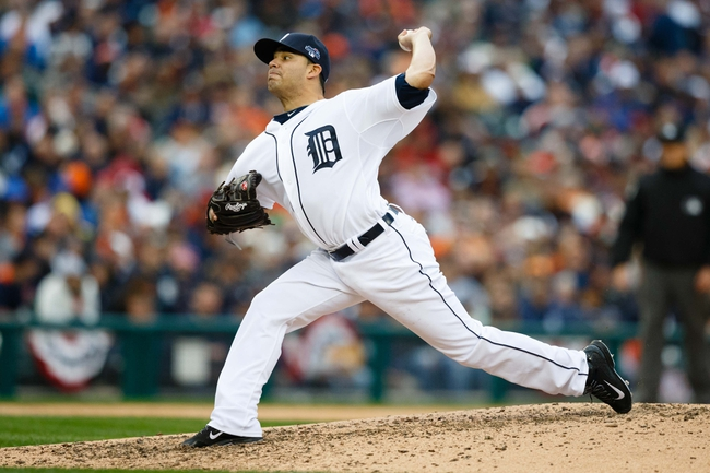 Oct 7, 2013; Detroit, MI, USA; Detroit Tigers starting pitcher Jose Alvarez (52) pitches in the seventh inning against the Oakland Athletics in game three of the American League divisional series playoff baseball game at Comerica Park. Mandatory Credit: Rick Osentoski-USA TODAY Sports