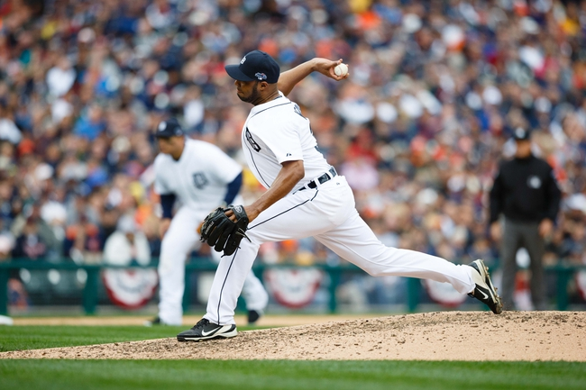 Oct 7, 2013; Detroit, MI, USA; Detroit Tigers relief pitcher Jose Veras (31) pitches against the Oakland Athletics in game three of the American League divisional series playoff baseball game at Comerica Park. Mandatory Credit: Rick Osentoski-USA TODAY Sports