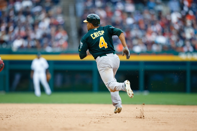 Oct 7, 2013; Detroit, MI, USA; Oakland Athletics center fielder Coco Crisp (4) runs to second base after he hits a double in the ninth inning against the Detroit Tigers in game three of the American League divisional series playoff baseball game at Comerica Park. Oakland won 6-3. Mandatory Credit: Rick Osentoski-USA TODAY Sports