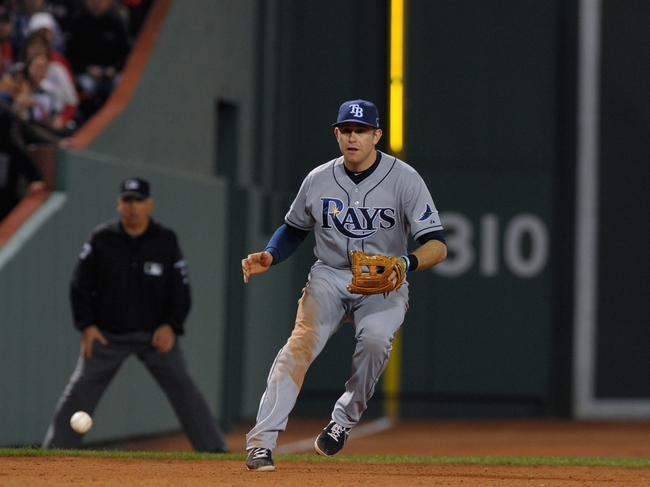 Oct 5, 2013; Boston, MA, USA; Tampa Bay Rays third baseman Evan Longoria (3) fields a ground ball during the eighth inning in game two of the American League divisional series playoff baseball game against the Boston Red Sox at Fenway Park. Mandatory Credit: Bob DeChiara-USA TODAY Sports