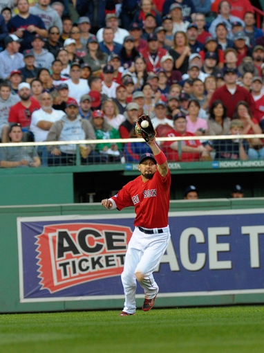 Oct 4, 2013; Boston, MA, USA; Boston Red Sox right fielder Shane Victorino (18) makes a catch during the eighth inning in game one of the American League divisional series playoff baseball game against the Tampa Bay Rays at Fenway Park. Mandatory Credit: Bob DeChiara-USA TODAY Sports