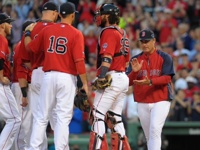 Oct 4, 2013; Boston, MA, USA; Boston Red Sox manager John Farrell (53) walks to the mound to relieve starting pitcher Jon Lester (31) in game one of the American League divisional series playoff baseball game against the Tampa Bay Rays at Fenway Park. Mandatory Credit: Bob DeChiara-USA TODAY Sports