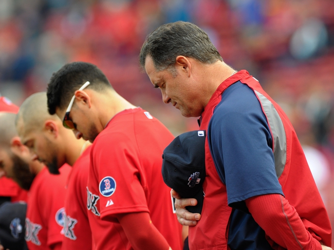 Oct 4, 2013; Boston, MA, USA; Boston Red Sox manager John Farrell (53) in a moment of silence prior to game one of the American League divisional series playoff baseball game against the Tampa Bay Rays at Fenway Park. Mandatory Credit: Bob DeChiara-USA TODAY Sports