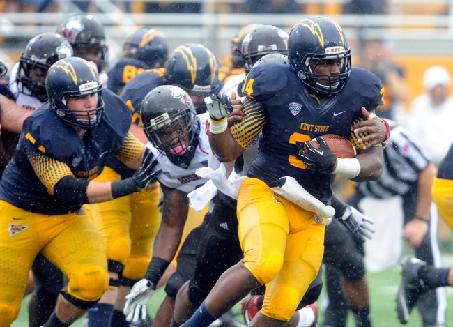Oct 5, 2013; Kent, OH, USA; Kent State Golden Flashes running back Trayion Durham (34) runs against the Northern Illinois Huskies at Dix Stadium. Northern Illinois beat Kent State 38-24. Mandatory Credit: Ken Blaze-USA TODAY Sports