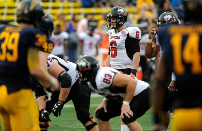 Oct 5, 2013; Kent, OH, USA; Northern Illinois Huskies quarterback Jordan Lynch (6) against the Kent State Golden Flashes at Dix Stadium. Northern Illinois beat Kent State 38-24. Mandatory Credit: Ken Blaze-USA TODAY Sports