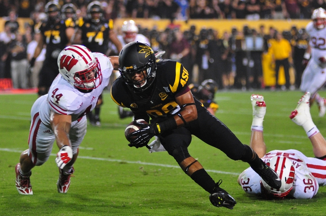 Sep 14, 2013; Tempe, AZ, USA; Arizona State Sun Devils wide receiver Frederick Gammage (89) is brought down at the 1 yard line by Wisconsin Badgers linebacker Chris Borland (44) during the game at Sun Devil Stadium. Mandatory Credit: Matt Kartozian-USA TODAY Sports