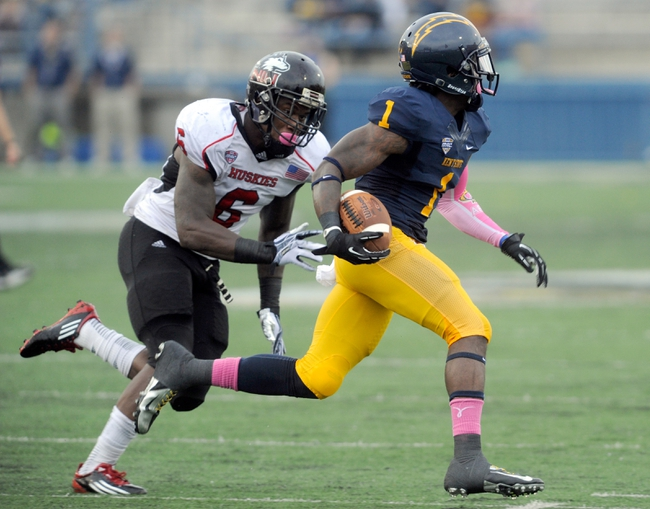 Oct 5, 2013; Kent, OH, USA; Kent State Golden Flashes running back Dri Archer (1) runs against Northern Illinois Huskies linebacker Jamaal Bass (6) at Dix Stadium. Northern Illinois beat Kent State 38-24. Mandatory Credit: Ken Blaze-USA TODAY Sports