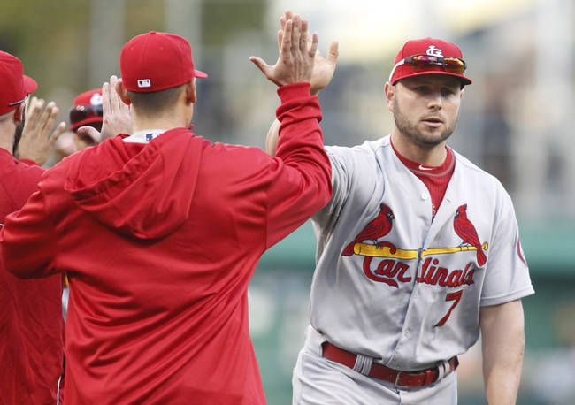 Oct 7, 2013; Pittsburgh, PA, USA; St. Louis Cardinals left fielder Matt Holliday (7) receives a high-five after playing the Pittsburgh Pirates in game four of the National League divisional series at PNC Park. The Cardinals won 2-1. Mandatory Credit: Charles LeClaire-USA TODAY Sports