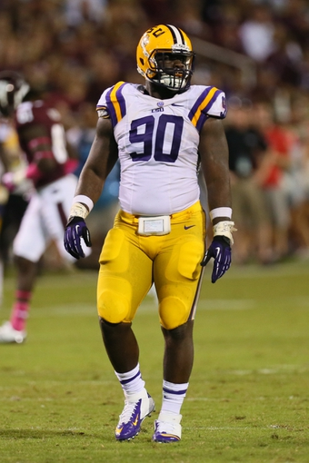 Oct 5, 2013; Starkville, MS, USA; LSU Tigers defensive tackle Anthony Johnson (90) during the game against the Mississippi State Bulldogs at Davis Wade Stadium.  LSU Tigers defeated the Mississippi State Bulldogs 59-26.  Mandatory Credit: Spruce Derden-USA TODAY Sports