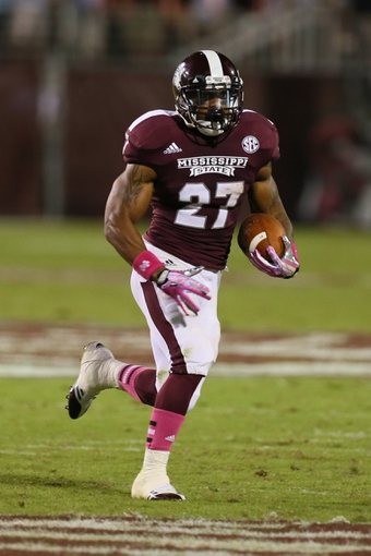 Oct 5, 2013; Starkville, MS, USA; Mississippi State Bulldogs running back LaDarius Perkins (27) advances the ball during the game against the LSU Tigers at Davis Wade Stadium.  LSU Tigers defeated the Mississippi State Bulldogs 59-26.  Mandatory Credit: Spruce Derden-USA TODAY Sports