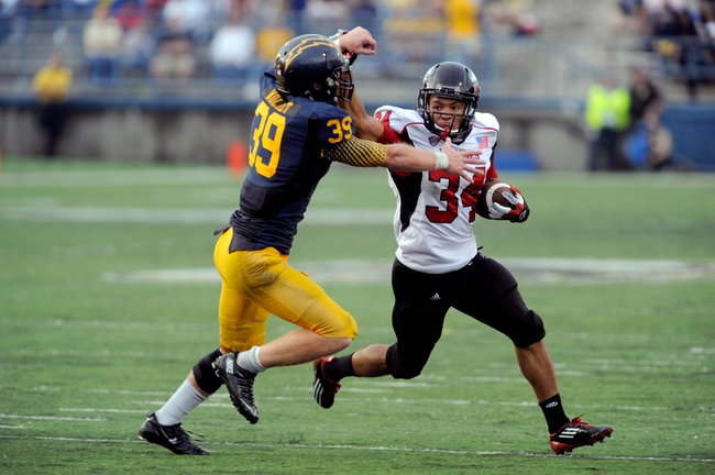Oct 5, 2013; Kent, OH, USA; Northern Illinois Huskies running back James Spencer (34) is taken down by Kent State Golden Flashes safety Luke Wollet (39) during the third quarter at Dix Stadium. Northern Illinois beat Kent State 38-24. Mandatory Credit: Ken Blaze-USA TODAY Sports