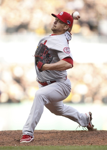 Oct 7, 2013; Pittsburgh, PA, USA; St. Louis Cardinals relief pitcher Trevor Rosenthal (26) delivers a pitch against the Pittsburgh Pirates during the ninth inning in game four of the National League divisional series at PNC Park. The Cardinals won 2-1. Mandatory Credit: Charles LeClaire-USA TODAY Sports