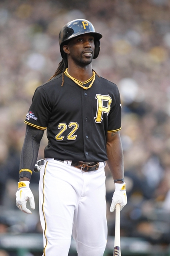 Oct 7, 2013; Pittsburgh, PA, USA; Pittsburgh Pirates center fielder Andrew McCutchen (22) in the on-deck circle against the St. Louis Cardinals during the ninth inning in game four of the National League divisional series at PNC Park. The Cardinals won 2-1. Mandatory Credit: Charles LeClaire-USA TODAY Sports