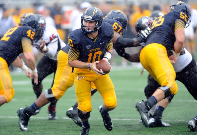 Oct 5, 2013; Kent, OH, USA; Kent State Golden Flashes quarterback Colin Reardon (10) against the Northern Illinois Huskies at Dix Stadium. Northern Illinois beat Kent State 38-24. Mandatory Credit: Ken Blaze-USA TODAY Sports