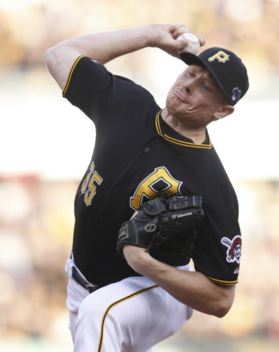 Oct 7, 2013; Pittsburgh, PA, USA; Pittsburgh Pirates relief pitcher Mark Melancon (35) delivers a pitch against the St. Louis Cardinals during the ninth inning in game four of the National League divisional series at PNC Park. The Cardinals won 2-1. Mandatory Credit: Charles LeClaire-USA TODAY Sports