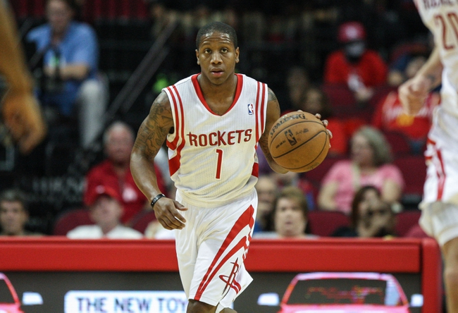 Oct 5, 2013; Houston, TX, USA; Houston Rockets point guard Isaiah Canaan (1) brings the ball up the court during the fourth quarter against the New Orleans Pelicans at Toyota Center. Mandatory Credit: Troy Taormina-USA TODAY Sports