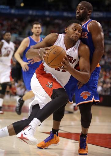 Oct 11, 2013; Toronto, Ontario, CAN; Toronto Raptors forward Rudy Gay (22) goes to the basket against New York Knicks point guard Raymond Felton (2) at Air Canada Centre. The Raptors beat the Knicks 100-91. Mandatory Credit: Tom Szczerbowski-USA TODAY Sports