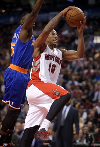 Oct 11, 2013; Toronto, Ontario, CAN; Toronto Raptors guard DeMar DeRozan (10) drives to the hoop to score a basket against the New York Knicks at Air Canada Centre. The Raptors beat the Knicks 100-91. Mandatory Credit: Tom Szczerbowski-USA TODAY Sports