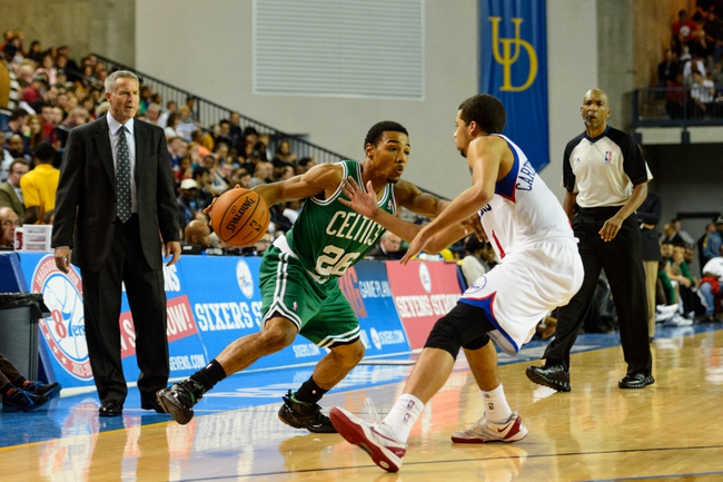 Oct 11, 2013; Newark, DE, USA; Boston Celtics guard Phil Pressey (26) is defended by Philadelphia 76ers guard Michael Carter-Williams (1) during the fourth quarter at Bob Carpenter Sports Convocation Center. The Sixers defeated the Celtics 97-85. Mandatory Credit: Howard Smith-USA TODAY Sports