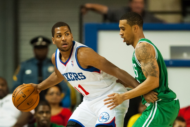 Oct 11, 2013; Newark, DE, USA; Philadelphia 76ers guard Khalif Wyatt (11) is defended by Boston Celtics guard guard Courtney Lee (11) during the fourth quarter at Bob Carpenter Sports Convocation Center. The Sixers defeated the Celtics 97-85. Mandatory Credit: Howard Smith-USA TODAY Sports