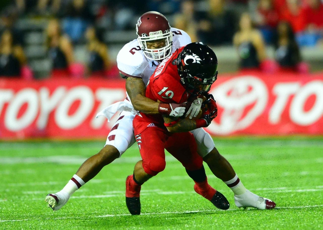 Oct 11, 2013; Cincinnati, OH, USA; Temple Owls defensive back Anthony Robey (2) tackles Cincinnati Bearcats wide receiver Shaq Washington (19) during the second quarter at Nippert Stadium. Mandatory Credit: Andrew Weber-USA TODAY Sports