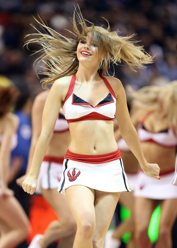 Oct 11, 2013; Toronto, Ontario, CAN; A member of the Toronto Raptors dance pack performs during the game against the New York Knicks at Air Canada Centre. The Raptors beat the Knicks 100-91. Mandatory Credit: Tom Szczerbowski-USA TODAY Sports