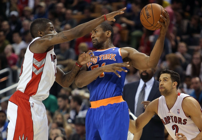 Oct 11, 2013; Toronto, Ontario, CAN; New York Knicks forward Metta World Peace (51) takes the ball away from the Raptors as Toronto Raptors point guard Dwight Buycks (13) defends at Air Canada Centre. The Raptors beat the Knicks 100-91. Mandatory Credit: Tom Szczerbowski-USA TODAY Sports