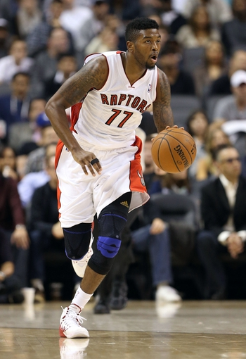 Oct 11, 2013; Toronto, Ontario, CAN; Toronto Raptors point guard Julyan Stone (77) brings the ball up the court against the New York Knicks at Air Canada Centre. The Raptors beat the Knicks 100-91. Mandatory Credit: Tom Szczerbowski-USA TODAY Sports