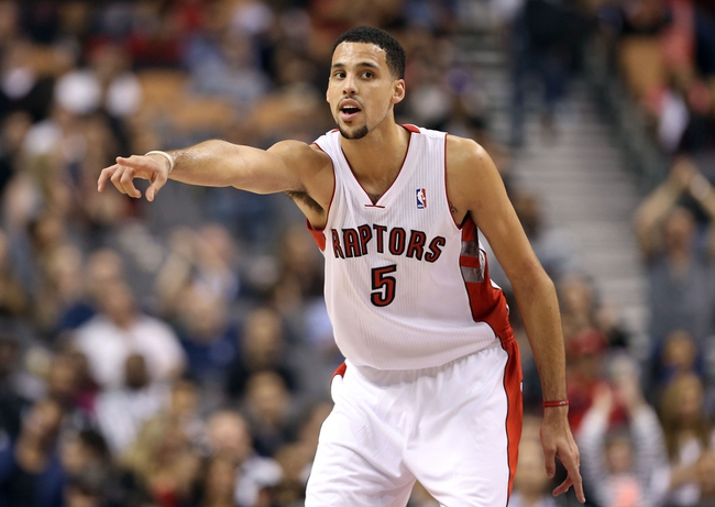 Oct 11, 2013; Toronto, Ontario, CAN; Toronto Raptors forward Austin Daye (5) yells instructions against the New York Knicks at Air Canada Centre. The Raptors beat the Knicks 100-91. Mandatory Credit: Tom Szczerbowski-USA TODAY Sports