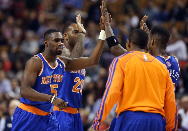 Oct 11, 2013; Toronto, Ontario, CAN; New York Knicks shooting guard Tim Hardaway Jr. (5) celebrates with teammates after the Knicks went on a scoring drive against the Toronto Raptors at Air Canada Centre. The Raptors beat the Knicks 100-91. Mandatory Credit: Tom Szczerbowski-USA TODAY Sports