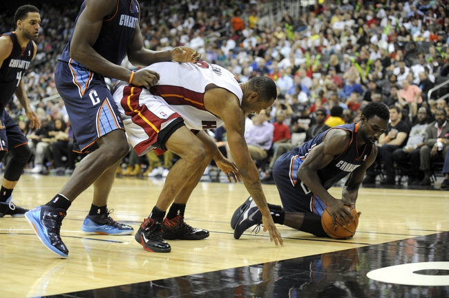 Oct 11, 2013; Kansas City, MO, USA; Miami Heat power forward Rashard Lewis (9) goes for a loose ball against Charlotte Bobcats small forward Jeffery Taylor (44) and guard Ben Gordon (8) in the second half at Sprint Center. Miami won 86-75. Mandatory Credit: John Rieger-USA TODAY Sports