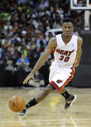 Oct 11, 2013; Kansas City, MO, USA; Miami Heat point guard Norris Cole (30) dribbles the ball against the Charlotte Bobcats  in the second half at Sprint Center. Miami won 86-75. Mandatory Credit: John Rieger-USA TODAY Sports