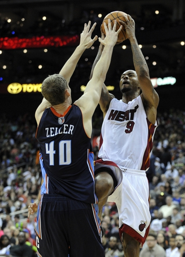Oct 11, 2013; Kansas City, MO, USA;  Miami Heat power forward Rashard Lewis (9) drives to the basket against Charlotte Bobcats power forward Cody Zeller (40) in the second half at Sprint Center. Miami won 86-75. Mandatory Credit: John Rieger-USA TODAY Sports