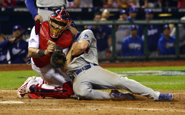 Oct 11, 2013; St. Louis, MO, USA; Los Angeles Dodgers second baseman Mark Ellis (right) is tagged out by St. Louis Cardinals catcher Yadier Molina (left) during the 10th inning in game one of the National League Championship Series baseball game at Busch Stadium. Mandatory Credit: Scott Rovak-USA TODAY Sports