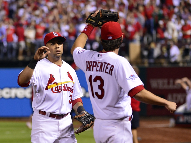 Oct 11, 2013; St. Louis, MO, USA; St. Louis Cardinals right fielder Carlos Beltran (3) is congratulated by second baseman Matt Carpenter (13) after throwing out Los Angeles Dodgers second baseman Mark Ellis (not pictured) at home plate in the 10th inning in game one of the National League Championship Series baseball game at Busch Stadium. Mandatory Credit: Scott Rovak-USA TODAY Sports