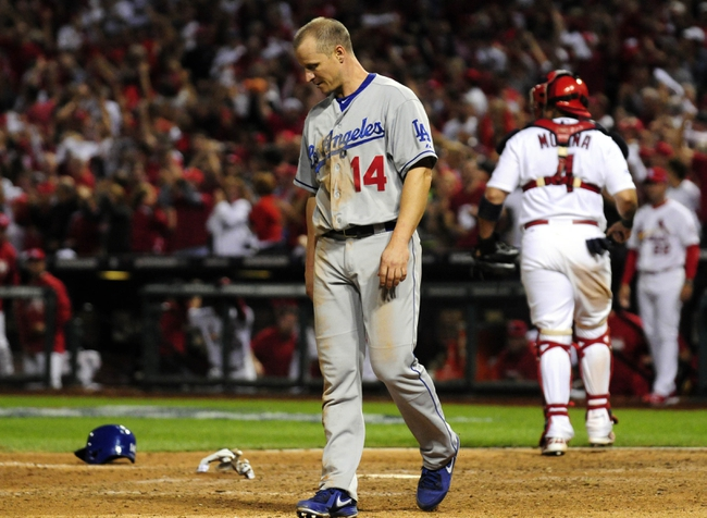 Oct 11, 2013; St. Louis, MO, USA; Los Angeles Dodgers second baseman Mark Ellis (14) reacts after being tagged out at home plate by St. Louis Cardinals catcher Yadier Molina (4) during the 10th inning in game one of the National League Championship Series baseball game at Busch Stadium. Mandatory Credit: Jeff Curry-USA TODAY Sports