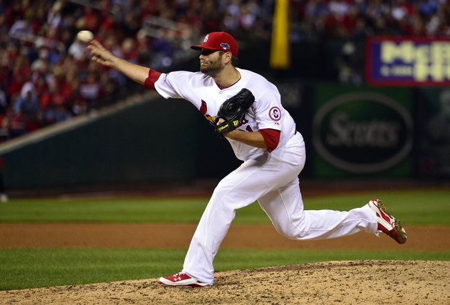Oct 11, 2013; St. Louis, MO, USA; St. Louis Cardinals pitcher Lance Lynn throws a pitch against the Los Angeles Dodgers in the 12th inning in game one of the National League Championship Series baseball game at Busch Stadium. Mandatory Credit: Scott Rovak-USA TODAY Sports