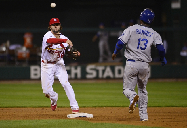Oct 11, 2013; St. Louis, MO, USA; St. Louis Cardinals shortstop Pete Kozma (38) turns a double play over Los Angeles Dodgers shortstop Hanley Ramirez (13) in the 12th inning in game one of the National League Championship Series baseball game at Busch Stadium. Mandatory Credit: Scott Rovak-USA TODAY Sports