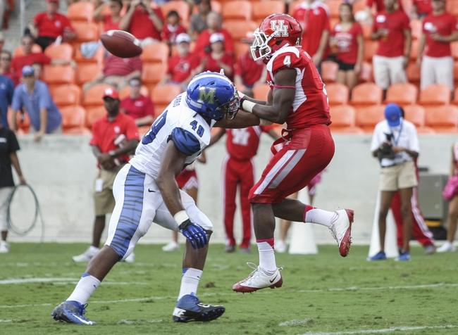 Oct 12, 2013; Houston, TX, USA; Houston Cougars wide receiver Daniel Spencer (4) catches a pass for a touchdown during the first quarter as Memphis Tigers linebacker Charles Harris (49) defends at BBVA Compass Stadium. Mandatory Credit: Troy Taormina-USA TODAY Sports