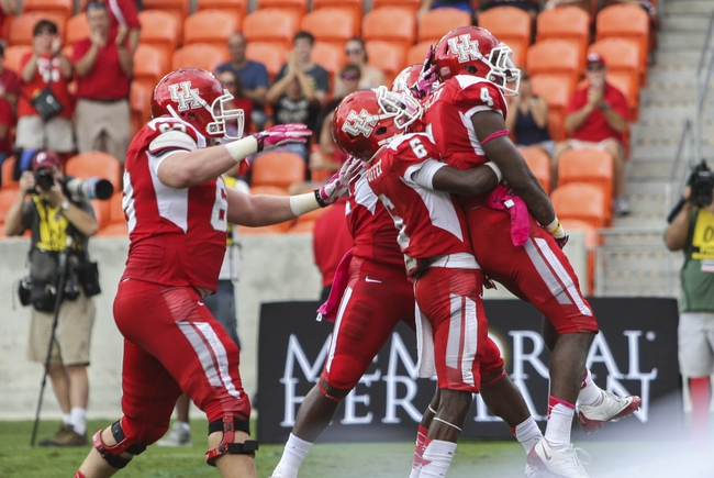 Oct 12, 2013; Houston, TX, USA; Houston Cougars wide receiver Daniel Spencer (4) is congratulated after scoring a touchdown during the first quarter against the Memphis Tigers at BBVA Compass Stadium. Mandatory Credit: Troy Taormina-USA TODAY Sports